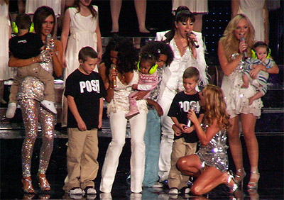 Spice Girls with children on stage